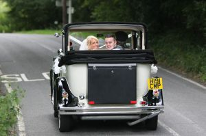 Gemma and Chris on their way to their reception